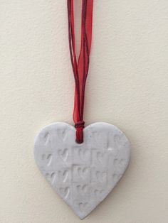 A personal favourite from my Etsy shop https://www.etsy.com/uk/listing/286167625/loveheart-hanger-gift-idea-pottery-one
