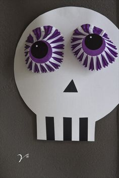 Halloween easy skull for kids to make with cup cake liners