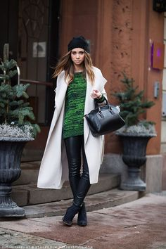 Consider pairing a beige coat with black leather slim pants to ooze class and sophistication. A pair of black suede booties will seamlessly integrate within a variety of outfits.  Shop this look for $98:  http://lookastic.com/women/looks/beanie-crew-neck-sweater-satchel-bag-coat-skinny-pants-ankle-boots/4841  — Black Beanie  — Green Crew-neck Sweater  — Black Leather Satchel Bag  — Beige Coat  — Black Leather Skinny Pants  — Black Suede Ankle Boots
