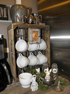 "an idea on how to ""fill"" a crate. decor. Maybe buy some mini twist hooks and hang mugs or tea cups! fill with moss and trinkets"