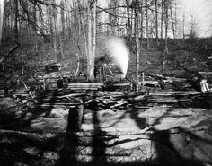 Picture depicts a sawmill operation in the days of steam powered mills.  Sawmill Operation For Logging--Blacksburg, VA