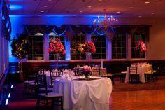 Wedding- The Log Cabin Ballroom, Holyoke, MA. Tall pilsner glass centerpieces by Durocher Florist, lighting by CJC Events