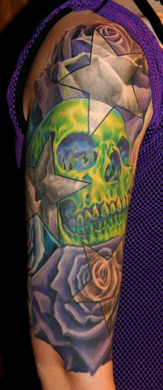 Tattoo skull flower | Off the Map Tattoo : Tattoos : Skull : Skull and Roses half-sleeve