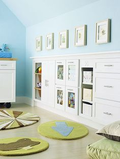 Installing a bank of cabinets in unused crawlspace provides oodles of storage. Cabinets with pullout baskets, open shelves, and see-through fronts mean toys are accessible to kids, but clothes, shoes, and other items can be hidden behind closed doors.