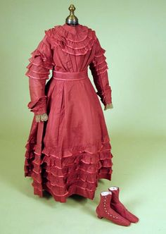 Red silk girl's dress and shoes, ca. 1870.
