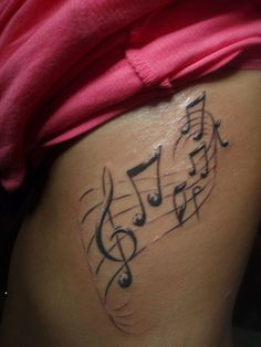 black and white tattoo ...music staff on ribs. So close to perfecting my design! I just know it..l