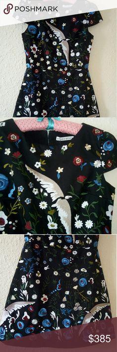 Alice and Olivia Embroidered Mini Dress US 4 Alice and Olivia Embroidered dress. All over Embroidered birds and flowers. Back hidden zipper closure. Size US4. Alice + Olivia Dresses Mini