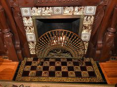 Fireplace with tiles and carved woodwork