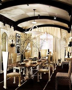 I love the triangle looking chairs, and the table, and the ceiling! Quite a good looking room!