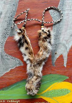 Bobcat paw necklace by Lupa. At http://thegreenwolf.etsy.com