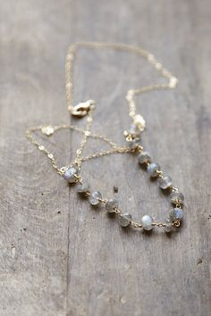 This minimal necklace is made up of a gorgeous 14k Gold fill chain that has been dotted with faceted labradorite rondelles. Each plump bead is