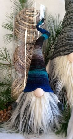 Swedish Norwegian TOMTE NISSE GNOME or SANTA can be used as Christmas Decor or all year round Decoration! Features bendable hat and arms to position any way you desire! Also added is a weighted bottom for extra stability! There may be slight differences in ones pictured as each one is individually handmade , every thread stitched carefully with lots of love! THE GNOME FEATURED FOR THIS LISTING, Has a beautiful hat with the colors of blues,greens,greys! Please Note: Hats that have multi…