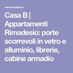 Casa B | Appartamenti Rimadesio: porte scorrevoli in vetro e alluminio, librerie, cabine armadio