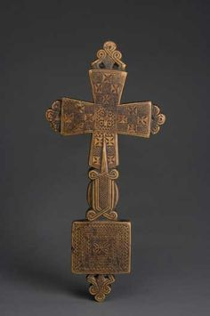This 15th century cross has lobes filled with crosses surrounding a central Maltese cross. When in use in religious processions, colorful banners would be draped through the loops on the bottom.