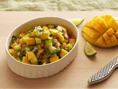 Mango Salsa : Ellie's summery twist on salsa includes mango and cucumber. Make homemade tortilla chips in minutes to scoop up the chunky goodness. via Food Network