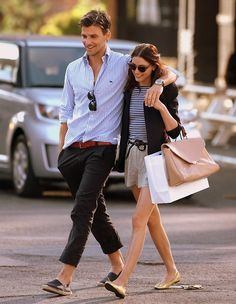 An adorable couple wearing casual clothing. It is functional because their clothing is lightweight and baggy which makes for room to breathe. The look is vey sophisticated  which makes it very beautiful and pleasing to look at.