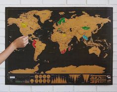 A scratch-off world map that will reveal its colors over the years. | 35 Things That Anyone With Wanderlust Will Love