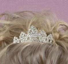The Mini Tiara Hair Comb is a beautiful tiara that is decorated with glittering silver rhinestones. Bridaltiara is perfect for your big day, whether it is your wedding, birthday, or any other event. This piece is sure to stand out!  #bridalhairaccessories, #daisydays