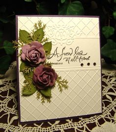 Beautiful card!  They probably used an embossing folder to get the background, but I would use my Score-Pal.  Love the roses!!!