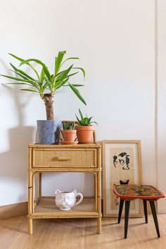"""Some trip treasures like the vintage stool decorated with traditional Russian art, and the original Chinese symbol sheet, bought by Arnau from Vietnam. The stool was found """"purchased in Els Encants, an antiquities market in Barcelona. Mireya loves traditional Russian art."""" The cat mug on the bottom shelf is from Urban Outfitters."""
