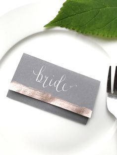 Grey and Rose Gold Place Name Card and Menu inside. Handwritten in dip ink calligraphy pen by Poppy and Pipkin.