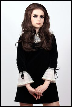 A 1960's dress from Velvet Cave.  I'm in love with everything about this.... Her 1960's hair and eye make up, the cameo, the way the dress is mod yet classically gothic. Just great.