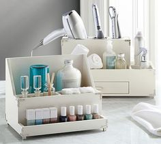 Pottery Barn's Campaign Storage lets you organize your nail care and hair styling products like a pro.
