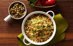 Fresh herbs, spicy fresno chiles, and roasted pistachios add a bold punch of flavor and texture contrast to this fluffy couscous.