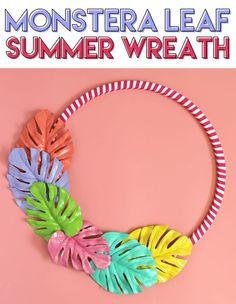 Make a colorful summer wreath out of painted monstera leaves. This DIY summer wreath was cheap and easy to make. LOVE the colors! #summerwreath #wreaths #crafts #diywreath #wreathdiy