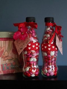 Coca-Cola bottles~cleaned filled with Valentine M's, add fun ribbons and you have an inexpensive gift :)