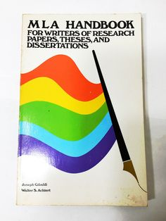 MLA Handbook. English writing style manual reference guide. First Edition Book. College University. Paperback book.