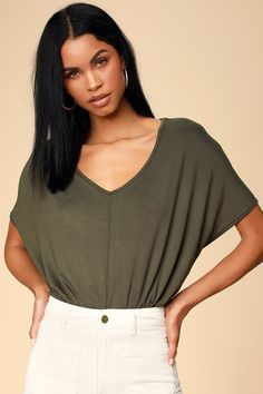 Keep it cute and casual in the Wallen Olive Green Oversized V-neck Tee Bodysuit! Jersey knit creates this oversized dolman sleeve tee bodysuit with a V-neck. Olive Green Bodysuit, Water Resistant Coats, Oversized Tee, Puffer Jackets, V Neck Tee, Tees, Long Sleeve, Casual, How To Wear