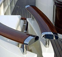 Polished timber hand rail with chrome finish end caps and struts