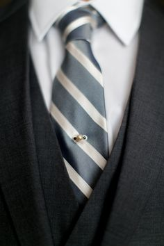 Groom's Grey & White Striped Tie with Pin | Photography: Arte De Vie. Read More: http://www.insideweddings.com/weddings/traditional-church-ceremony-country-club-reception-in-new-orleans/719/