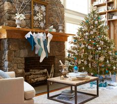 Winter details like snowflakes and icy blues are expertly balanced with a tall stone hearth and a warm knotty wood mantel in this cozy cabin. - Traditional Home ®