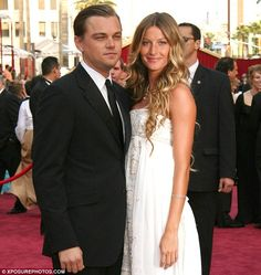 Woah i forgot this happened! Leonardo with former Victorias Secret Angel and girlfriend Gisele Bundchen in 2005