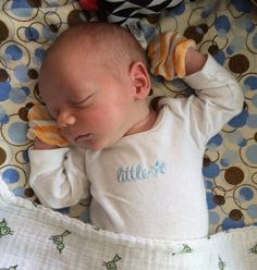 My younger son is growing. He is now rolling back and forth. He's big for his age; not yet five months, the six months outfits are too small, and most nine months outfits are just right. He's a hap…