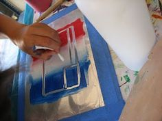 Printmaking - tempera paint on tin foil, put a piece of paper on top them roll over with a brayer