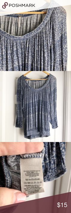 Free People Peasant Blouse Flowy and soft, this peasant blouse style top by Free People is so flattering and light for the coming seasons! Blue and white floral swirl pattern with a cool rough hemmed neckline! Great condition! Free People Tops