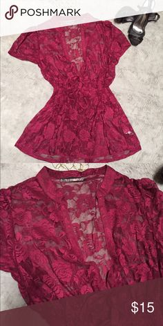 Maroon lace blouse So cite on this full lace blouse (didn't come with a shell underneath) is great over a tank. Has a deep Vneck a gathered stretch waist and long bow tie at the bottom of the V. Maurices Tops Blouses