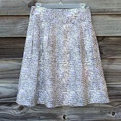 Banana Republic grey skirt.   NWOT Shades of grey with a touch of lavender. 22 inches long. 14 in waist measures flat. Fully lined. 100% silk shell. Side pockets. Banana Republic Skirts