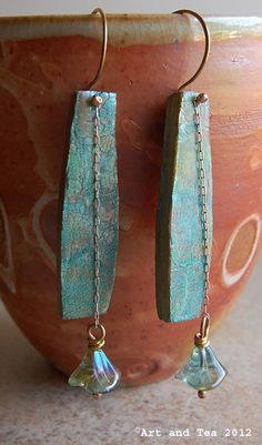 These earrings were created from a polymer clay sheet that was painted with alcohol ink, sprinkled with mica powder and then run through a pasta machine when everything dried.
