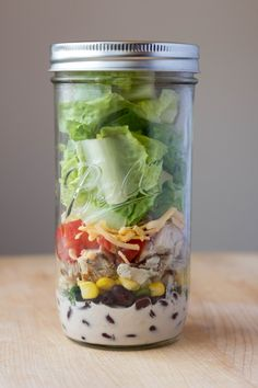 Bring your barbeque chicken salad lunch in a mason jar. Convenient & chic.