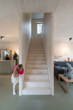 A Staircase Divides The Ground Floor Into Zones For The Kitchen And Living  Area. Timber