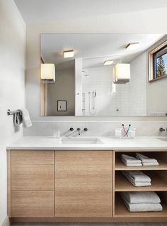 Light Wood Vanity With Exposed Shelves - Light wood and white counters work well together
