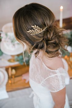gold hair accessories - photo by JOJO Photography and Film http://ruffledblog.com/soft-bridal-wedding-inspiration