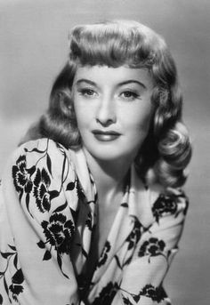 Actress, Barbara Stanwyck sports a classic 1940's style hairdo in the 1945 film noir classic, DOUBLE INDEMNITY.