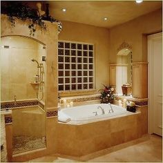 Side by side shower and tub, frosted glass cubes over tub instead of window, no space over shower, move faucets on tub to ends or other side
