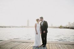 waterfront wedding inspiration, must have wedding photos, simple modern wedding dress  from metallic modern baltimore harbor wedding by Love life images