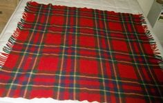 """Vintage Troy Robe Red Blue & Green Plaid Wool Stadium Fringe Blanket 50"""" x 50"""" This auction is for a well made Vintage Troy Robe Red Blue & Green Plaid Wool Stadium Fringe Blanket. Measures 50"""" x 50"""". The blanket is clean with no stains odors or damage. We do not end auctions early for any reason and will not try to contact you before an auction ends. Thank you. Payment is due within 3 days of auctions end. Paypal only. Thank you. Items are shipped USPS. If shipping isn't quoted on the…"""